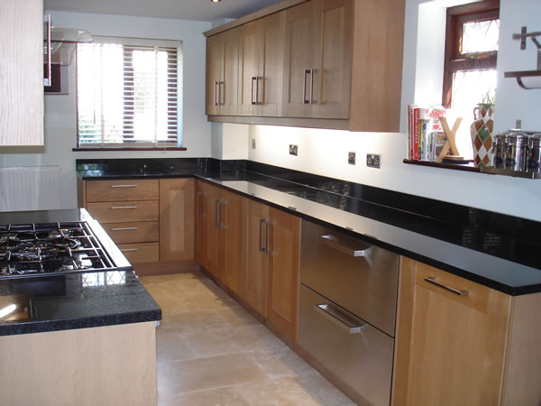 Kitchen - Rutland Oak doors and granite worktops - Bishops  Stortford, Hertfordshire (Herts) by Peter Hamilton Kitchens